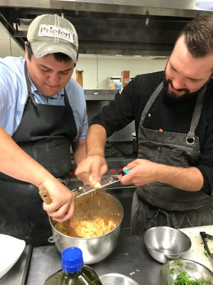 Anthony Grafton (left) and Chandler Mikeska does a demonstration for Gayle Bickel's second-year students in the Culinary Arts program at Central High School on Friday, Sept. 8.