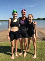 Sara Hankes (middle) with daughters Caitlyn (left)