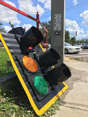A downed traffic light at Fowler and Edison avenues. Drivers are required by law to treat inoperable traffic lights as four-way stops. But crashes are occurring at some intersections with non-functioning lights.