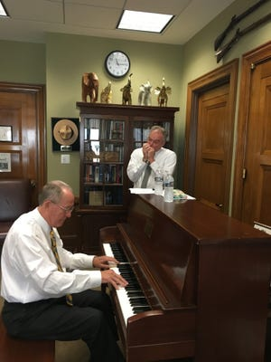 Sen. Lamar Alexander, on piano, and Sen. Tim Kaine, on harmonica, rehearse in Alexander's office for their upcoming performance at the Bristol Rhythm and Roots Reunion music festival.
