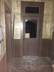 Vandals broke glass and kicked in doors at the Tulare