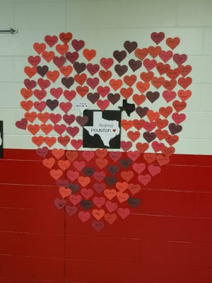 A collection of hearts, showing the support of students and staff at Mary Welsh Elementary School, Williamsburg, covers this hallway wall at the school.