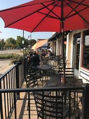 Artisan 179 has a patio across the street from Pewaukee Lake.