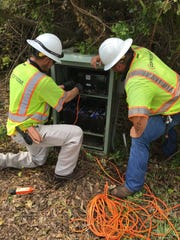 Comcast network technicians working to repair distribution equipment in Fprt Myers.