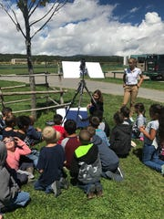 Ruidoso students having a solar learning experience during the recent solar eclipse.
