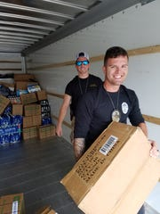 Members of the Fort Myers Police Department load a