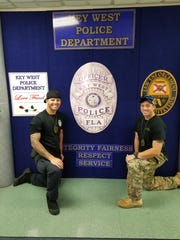 Fort Myers police officers Andrew Barlow, left, and