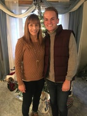 Wade Snowden's mother, Carla, supports his quest to run a marathon. The pair are pictured in December 2016.