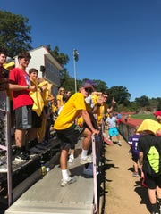 The crowd wore commemorative yellow shirts during the