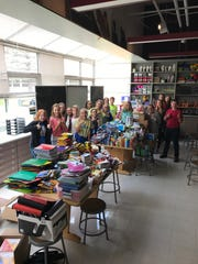 Students at Park View Middle School in Mukwonago collect and organize school supplies and other items for Hurricane Harvey victims in Texas.