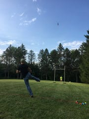 Andy Manuele tosses his chicken in the annual Chicken Fling in Stone Bank.