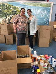 Donations of cases of water, canned goods, hygiene