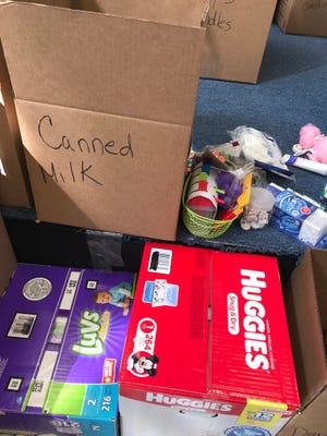 Donations of cases of water, canned goods, hygiene products and other products have been dropped off in Perth Amboy to be sent to Puerto Rico following Hurricane Maria.