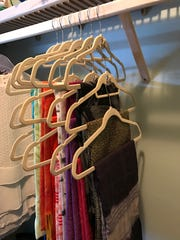 The secret to this system is limiting each section to no more than three hangers, which makes it easier to get to the first and second scarf.