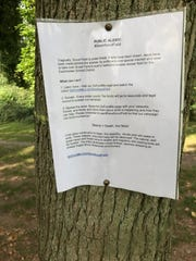 A sign posted by Friends of Scout Field opposing a