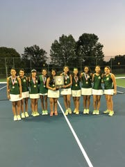 The J.P. Stevens girls tennis team pose after winning