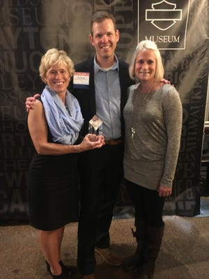 Jeri Dreikosen, SASD Wellness Coordinator, and Sara Seifert, Assistant Wellness Coordinator, accepted the Gold Well Worksite Award from Tyler Roberts, Executive Director of the Wellness Council of Wisconsin at the State Wellness Conference Awards Night in Milwaukee.