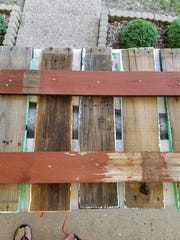 Step 2: Space your finished pieces to your desired size, face down, on a hard surface. Take spare lumber to use as back braces