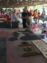 Patrons shop at the Greenbrier Flea Market, open Saturdays