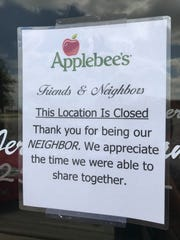 A sign on the door announces that Applebee's Neighborhood Grill and Bar is closed Monday, Oct. 2, 2017.