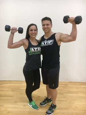 Kenzie Douglas, left, and Bill Ruehlmann have started Aspire to Inspire Fitness (ATIF) at their home in near Brooklyn. ATIF is a company that specializes in weight loss transformations.