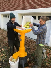 Ryan Blosser and Trevor Piersol load apples into a