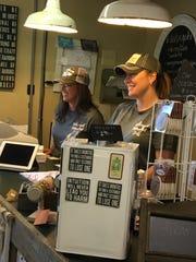 Vivian Weaver and Jamie Rector greet customers inside