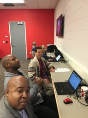 From lower left: Vince Ellis, Rod Beard, James Edwards III and Ansar Khan. Radio personality Art Regner in the back, isn't part of the Pistons beat crew.