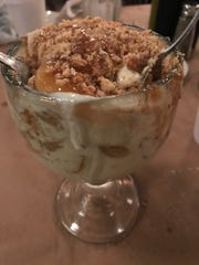 Spageddie's Apple Cinnamon Crumble has large chunks of hot cinnamon apples and smooth vanilla ice cream with caramel sauce and almond biscotti crumbles mixed together.