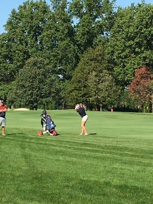 Lakota freshman Kyleigh Dull hits an iron shot on No. 4 at the Division II girls state golf tournament.