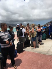 Irma evacuees from Sint Maarten wait in line to board the Royal Caribbean's Adventure of the Seas.