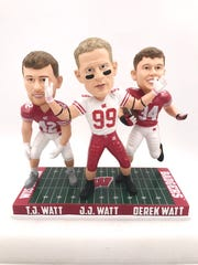 The three Watt brothers (from left) T.J., J.J. and