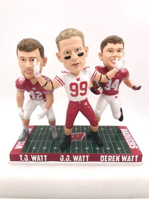 The three Watt brothers (from left) T.J., J.J. and Derek are portrayed in a bobblehead produced by the National Bobblehead Hall of Fame and Museum.