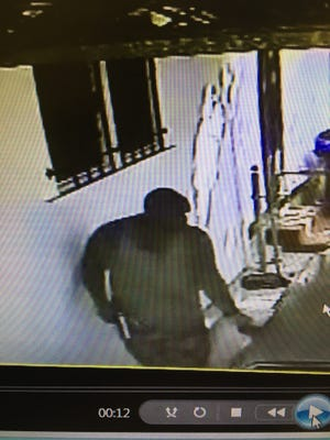 Armed robbery suspect caught on surveillance video.
