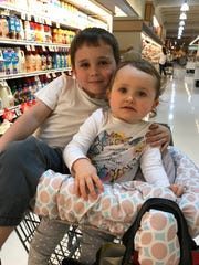 Cordelia Burrows, 2, with her big brother Clark Burrows, 5, of Staunton, at the grocery store with their mom, Miriam Burrows.
