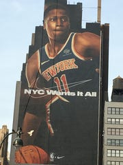A photo of Frank Ntilikina hangs high near Madison Square Garden.