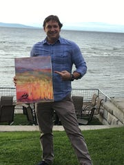 Kevin Grace poses with the Katharine Montstream painting he discovered Oct. 13 near the St. John's Club in Burlington.