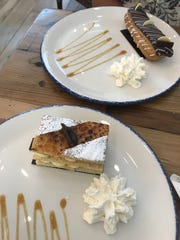 A chocolate eclair and napoleon pastry at La Colmar