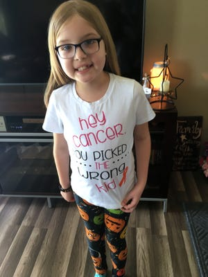 McKenzie Woods, 8, wears a shirt designed for her. The Craigsville Elementary student was recently diagnosed with leukemia.