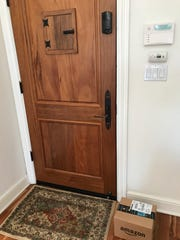A package left just inside the door at a rental house in San Francisco by Amazon's Key delivery service, which allows drivers to open the customer's door via the Amazon Key app.