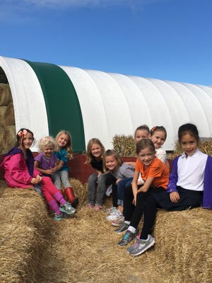 First graders in Miss Karly Cross's class at Immaculate Conception School in Port Clinton enjoyed a recent beautiful fall day at Jason's Pumpkin Patch in Oak Harbor.