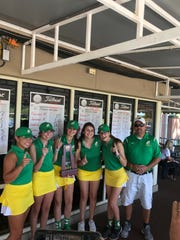 The Catholic High girls golf team celebrates their win in Tuesday's Region 1-1A Tournament in Tallahassee to advance into the state tournament.