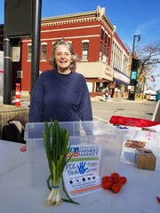 Market visitors could find Donna King at the corner of First and Main each weekend to drop off donations.