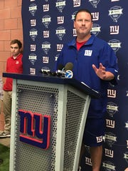 Giants coach Ben McAdoo talks to reporters Monday as the team returns from its bye week.