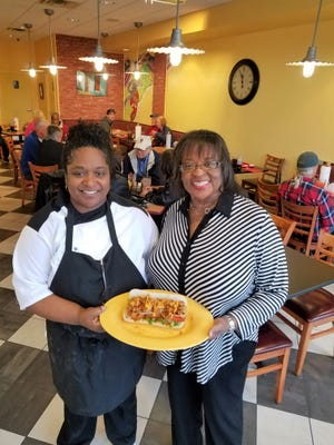 Kim Hinton, right, and Ava Demps, left, are known as Mary and Martha to church friends and patrons of their successful Southern restaurant.