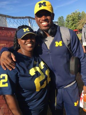 Michigan running back Karan Higdon and his mother,  Samantha Christian