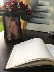 A book of condolence is open next to a portrait of victim of the New York terror attack Ann-Laure Decadt in a community centre in Staden Belgium  Wednesday Nov. 1, 2017. Ann-Laure Decadt, 31 and a mother of three-year-old and three-month-old sons, was the Belgian victim in New York's bike path attack near the World Trade Center on Tuesday. (AP Photo/Sylvain Plazy)