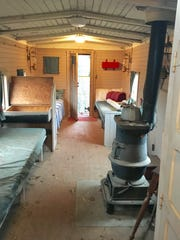 The inside of the caboose has a pot-bellied stove.