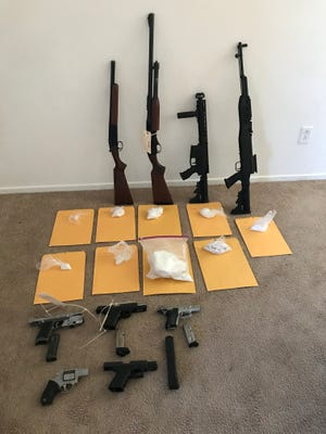 Two assault rifles, two shotguns, five handguns, 2 pounds of suspected methamphetamine and 1 pound of suspected cocaine were seized by police after serving a search warrant at a Coachella home on Friday, Nov. 3, 2017.