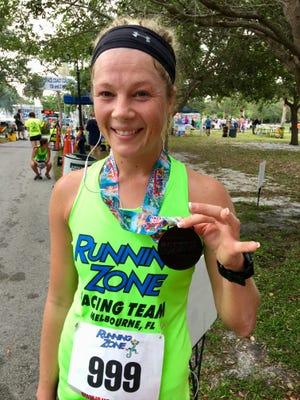 15K women's winner Jennifer Absher at the Space Coast Classic on Sunday